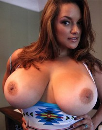 Beautiful big tit latina MILF revealing her enormous big boobs.