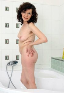 Still curvy mature housewife in the shower