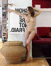 Fully naked girlfriend posing in the studio arts