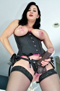 Big titted brunette MILF in fetish clothes with strap-on