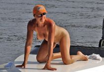 Big tits mature lady with protruding nipples sunbathing on the boat