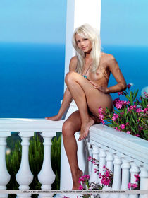 Naked blonde girl demonstrating tiny tits and bald twat outdoors