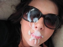 Some nice thick splooge all over her glasses.