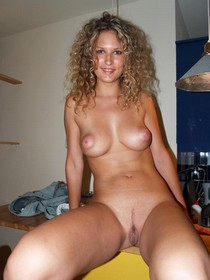 Hot curly blonde showing her awesome tits and tight pussy crack