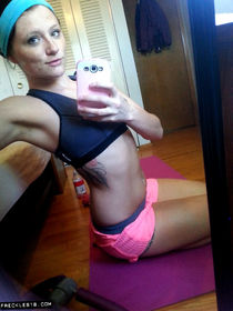 Pierced amateur Freckles takes selfie photos posing in shorts and sexy panties