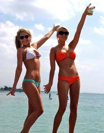 Beautiful young girls with round asses in bikini