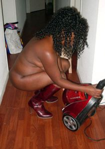 Mature black housewife with a vacuum cleaner. I like to see how naked, black mom clean..