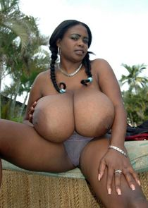 Superb ebony model Miosotis squeezing her huge breasts outdoor