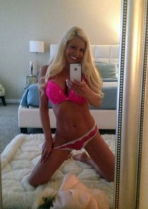 Hot blonde in pink lingerie selfie