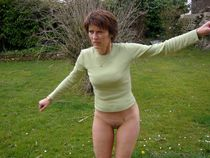 Thin mature ex-wife undressing in forest