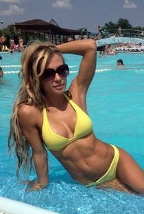 Handsome body of blonde with big natural nice breasts in cute yellow bikini
