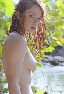 Beautiful redhead in the rain.