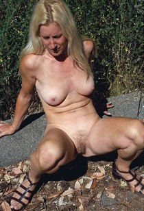 Old granny with her legs wide open , huge gaping pussy.