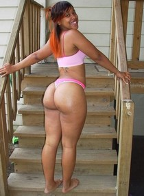Sweet ebony showing her big ass in sexy thong and big tits