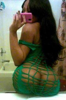 Ass caught between green fishnets