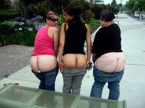 Three beautiful ladies showing off their bare bottoms.