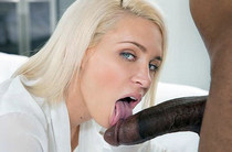 Blonde diligently licking a black forehead