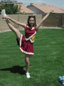 Pictures of two teen cheerleaders practicing their moves out