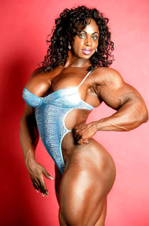 Massive black muscular Goddess with big boobs posing sexy -