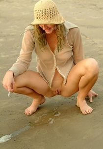 Girl peeing herself beach - Other