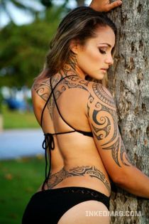 evil tattoo: sexy girl tribal tattoo on lower back and arm