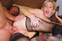 Busty blond MILF in stockings Kasey Grant bouncing on a ...