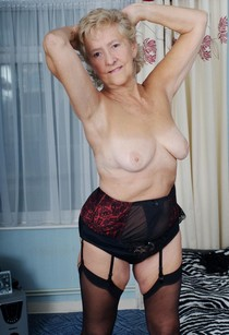60plus granny pose in sexy lingerie.