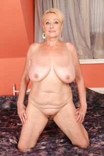 Fatty mature blonde with big jugs stripping and posing naked