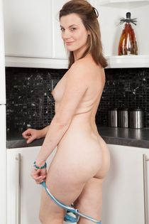 Sofia Matthews - milf (age 41) strips and poses in the kitch