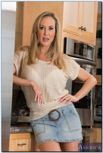 Stunning MILF on high heels Brandi Love stripping down in th