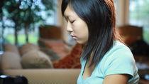 "Стоковое видео ""A Pretty Asian Teenager Playing"".."