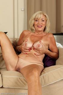 Older mature Kamilla slips off her white lingerie to offer h