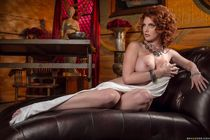 Redhead model Lilith Lust slips out of an evening dress to p