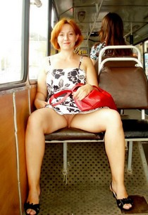 Mature Redhead Without Panties Spreads Legs In Public