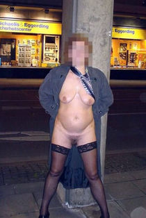 Horny mature wife poses naked outside around town