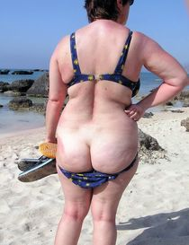 Naked old nudist at the beach. This aged bitch a real freak, in public