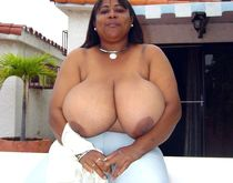 Mature african whore Iris, exposes her huge natural boobs
