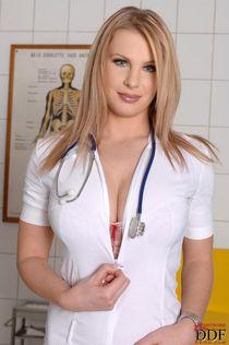 Big titted nurse Lovisa Nea undressing in the anatomy room