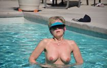 Busty milf nude in the pool