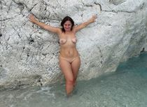 Nude MILF posing naked in the sea at vacation photo