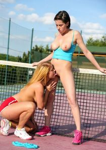 Two tennis girls making lesbian love on the court