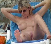 Beautiful amateur girls and hot mature women sunbathing topless and totally nude at..