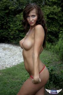 Big tit amateur model London Hart strips off her sexy red bikini outdoors