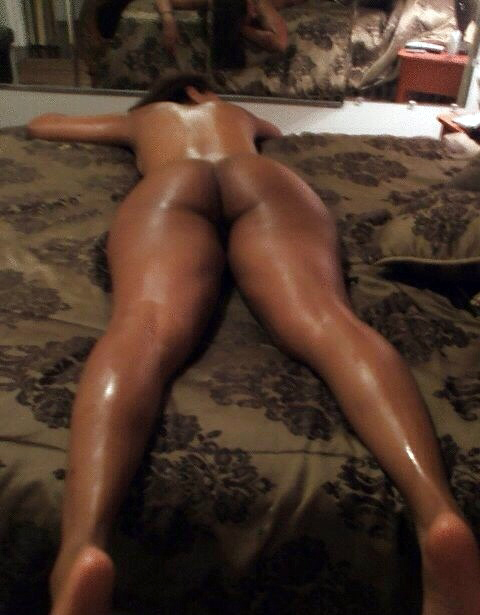 black girl laying in a bed naked